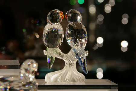 WATTENS, AUSTRIA - May 07, 2009: Couple of parrots made with crystal Swarovski at Crystal Worlds (Kristallwelten) museum. Swarovski is an Austrian producer of luxury cut lead glass found in 1895