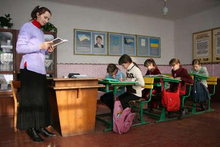 POCHAPY, UKRAINE - 03 December 2008: School teacher gives a lesson in a classroom