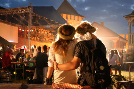 LUTSK, UKRAINE - 29 June 2008: Young couple relaxing at a open-air music festival