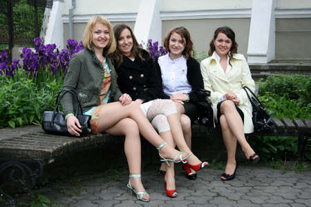 LUTSK, UKRAINE - 24 May 2008: Group of four unknown girls sitting on bench Editorial