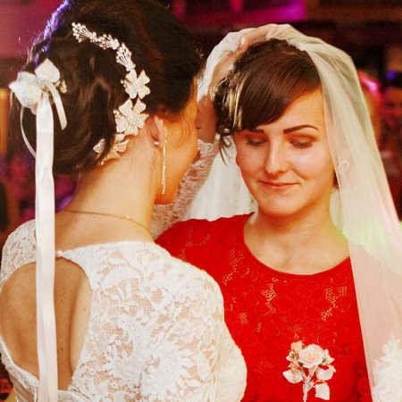 GOLOBY, UKRAINE - 20 September 2015: Bridesmaid dance in the brides veil
