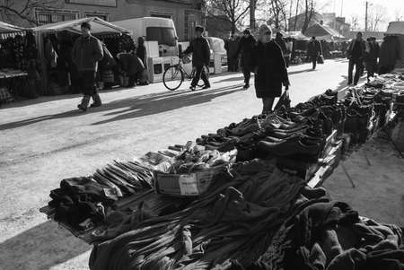 ZABOLOTTIA, UKRAINE - 20 January 2009: Shopping tents and people in the local market in winter Editorial