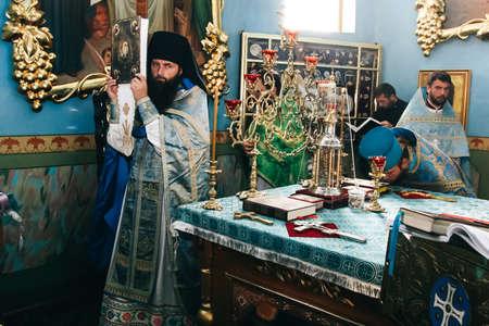 VOYUTYN, UKRAINE - 14 OCTOBER 2008: Orthodox priest during celebration Pokrov at altar