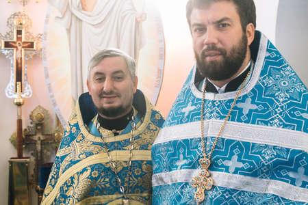 VOYUTYN, UKRAINE - 14 OCTOBER 2017: Orthodox priest during celebration Pokrov