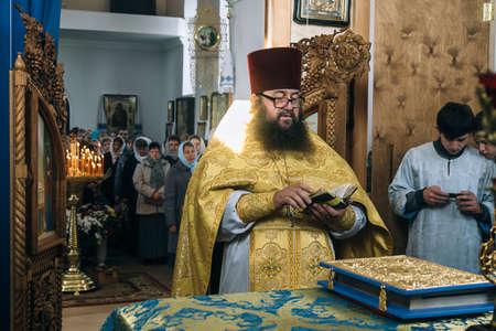 VOYUTYN, Volyn  UKRAINE - OCTOBER 14 2017: Orthodox priest during celebration Pokrov