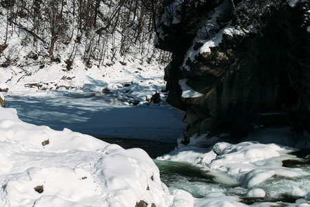 Small river at winter with snow