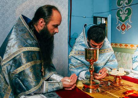 Voyutyn, Volyn  UKRAINE - October 14 2014: Priests consecrates bread during orthodox liturgy ceremony