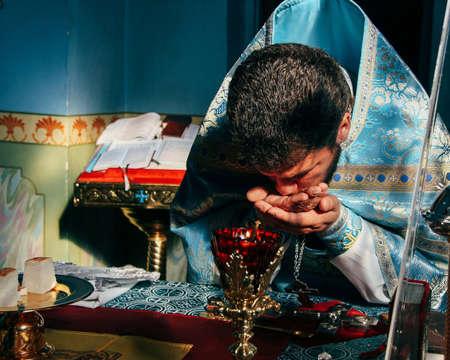 Voyutyn, Volyn  UKRAINE - October 14 2014: Priest consecrates bread during orthodox liturgy ceremony