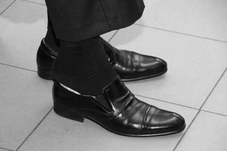 Groom wearing classic shoes on wedding day 写真素材