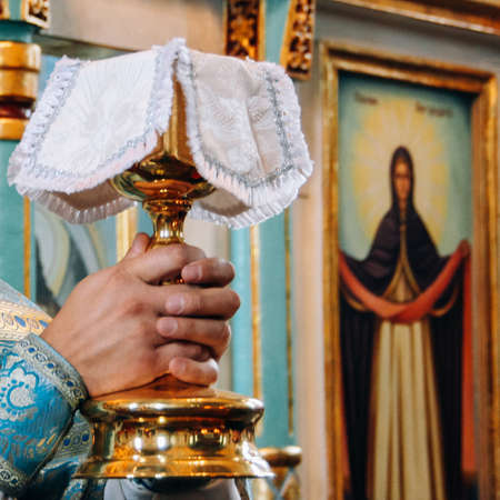 Hands of priest during orthodox liturgy ceremony