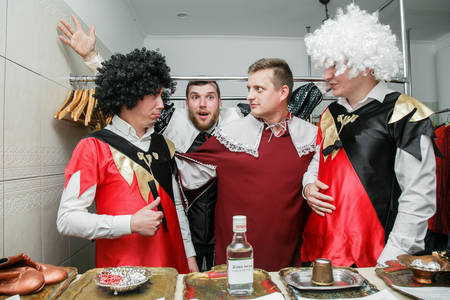 Cuman, Volyn / Ukraine - April 29 2018: Four eccentric men in the vintage clothes of the musketeer during wedding party at restaurant Banque d'images - 108089421