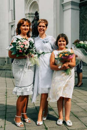 LUTSK,Volyn   UKRAINE - July 26 2009:- Bride with guests near church