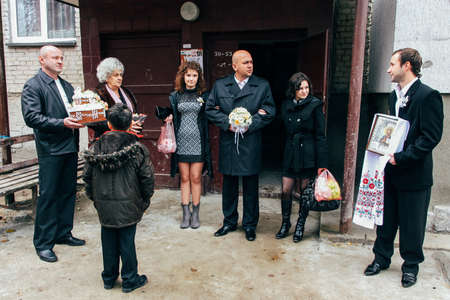 Lutsk, Volyn  Ukraine - November 14 2009: The groom with bridesmaids waits at the exit of the house