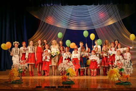 Lutsk, Volyn  Ukraine - May 31 2018: Children choir in the Ukrainian national costume performs at a charity concert in the theater Editorial