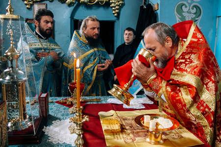 Voyutyn, Volyn  UKRAINE - October 14 2009: Priests during orthodox liturgy ceremony