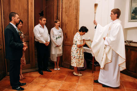 Lutsk, Volyn  Ukraine - July 26 2009: The priest sanctifies the couple during the wedding ceremony in the church 新聞圖片