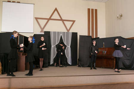 Lutsk, Volyn  Ukraine - January 27 2019: Woman and children with candles during performing in local Jewish community on the International Holocaust Remembrance Day