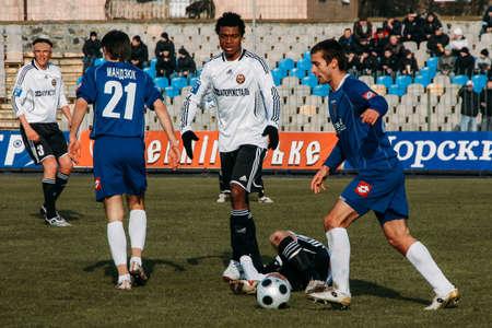 Lutsk, Volyn  Ukraine - March 21 2009: Soccer player injured during football match