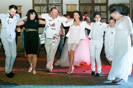 Cuman, Volyn  Ukraine - April 29 2018: : People dancing and having fun at wedding reception next to restaurant