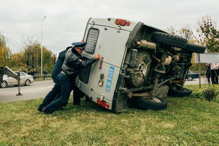 Lutsk, Volyn / Ukraine - October 29 2009: Police turn over car for the transportation of prisoners after an accident Editöryel