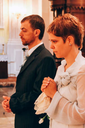 Wedding couple in christianity church Stock Photo