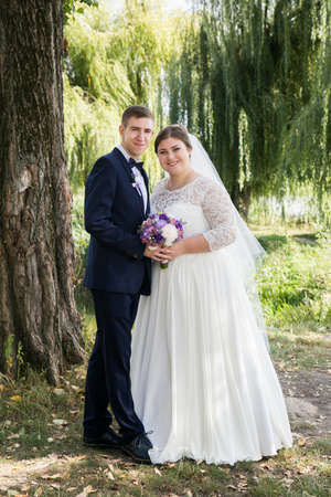 Lutsk, Volyn  Ukraine - September 16 2018: Bride and groom posing together outdoors on a wedding day