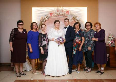 Lutsk, Volyn  Ukraine - September 16 2018: Groom and bride with guests posing in restaurant