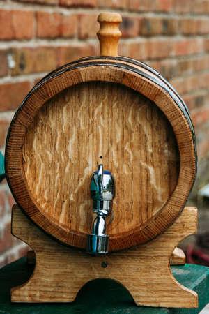 Wooden oak wine barrel with an iron tap in outdoors Reklamní fotografie