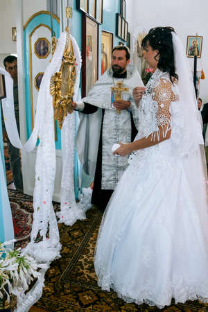 Lutsk, Volyn  Ukraine - August 30 2009: Wedding in Orthodox church Sajtókép