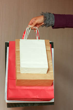 Close up of woman hand holding shopping bags Stok Fotoğraf