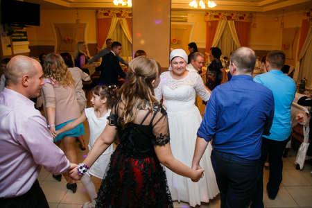 Lutsk, Volyn  Ukraine - September 16 2018: Newlywed couple and their friends dancing and having fun in restaurant Sajtókép