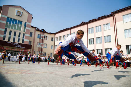 Lutsk, Volyn  Ukraine - September 01 2018: Ensemble of folk dancing in ukrainian traditional clothing performing during  the ceremony of opening the new school