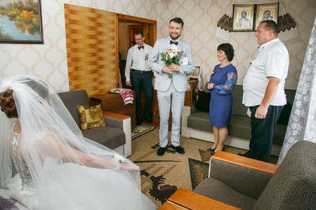 Cuman, Volyn  Ukraine - April 29 2018: The groom sees the bride for the first time before the ceremony