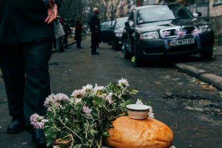 Lutsk, Ukraine - November 14 2009: Ukrainian wedding tradition - the neighbors meet brides with bread and salt near the house