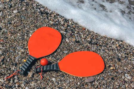 Beach rackets and ball for play on the beach
