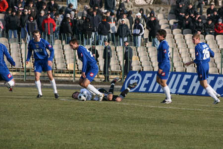 Lutsk, Volyn / Ukraine - March 21 2009: Soccer player injured during football match 에디토리얼