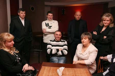 Lutsk, Volyn / Ukraine - February 06 2010: Men and women having meeting at restaurant