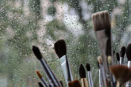 rain window: Brushes and rain window background Stock Photo