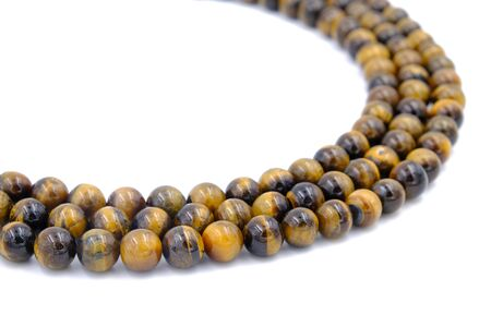 tiger eye stone beads necklace isolated on white background