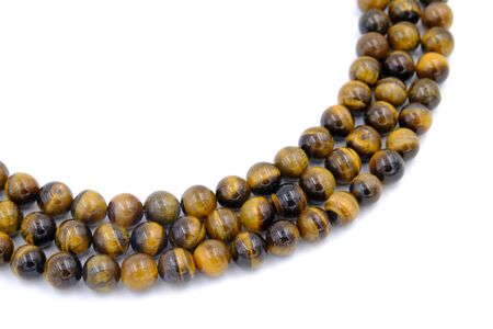 tiger eye stone beads necklace isolated on white background Фото со стока - 129325293