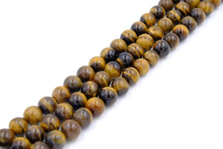 tiger eye stone beads necklace isolated on white background Фото со стока - 129325290