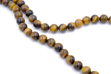 tiger eye stone beads isolated on white background