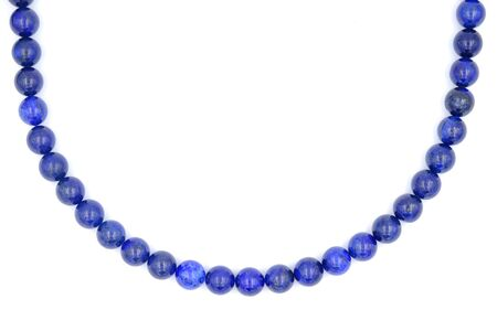 Single layer of blue lapis lazuli natural stone necklace isolated on white background Фото со стока - 129325315