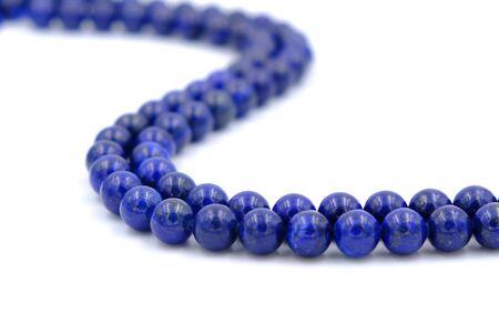 Blue lapis lazuli natural stone round shape bead isolated on white background Archivio Fotografico