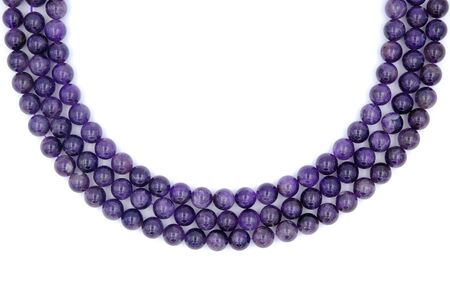 3 layer of purple amethyst natural stone necklace isolated on white background Фото со стока
