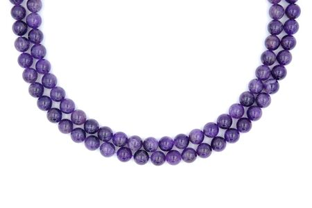2 layer of purple amethyst natural stone necklace isolated on white background Фото со стока