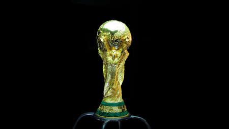 SARAJEVO, BOSNIA AND HERZEGOVINA - MARCH 2014: World Cup Trophy on a black Background, World Cup Trophy, was introduced in 1974. Made of 18 carat gold with a malachite base.