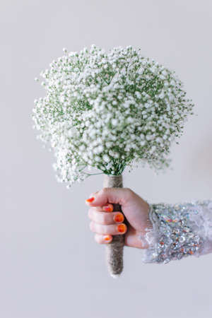 Brides hold the beautiful hand bouquet for her wedding Фото со стока
