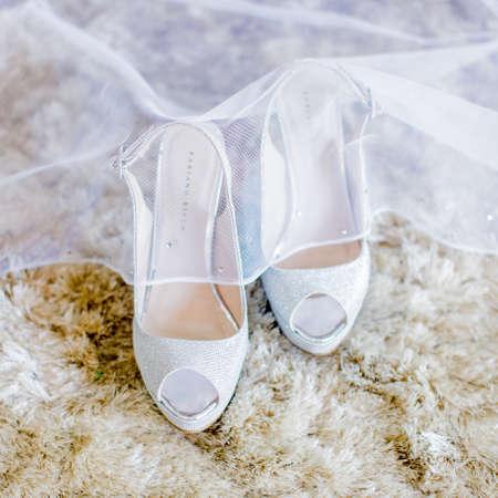 MELAKA, MALAYSIA - AUGUST 3, 2017 : Elegant wedding high heel shoe design by Fabiano Ricco. Fabiano Ricco is a fashion house specialising in shoes, handbags, accessories and fragrances. Редакционное