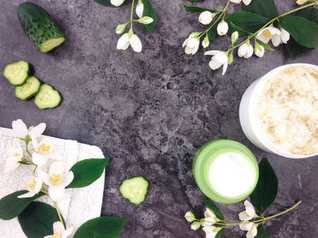 cucumbers: Set of spa treatment products and jasmine flowers on stone background. Flat lay
